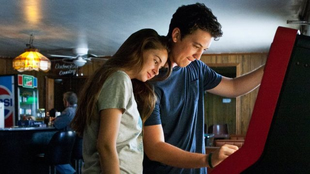 Shailene Woodley and Miles Teller cuddle up in 'The Spectacular Now'.