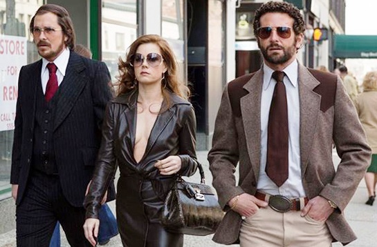 Christian Bale, Amy Adams, and Bradley Cooper strut in 'American Hustle'