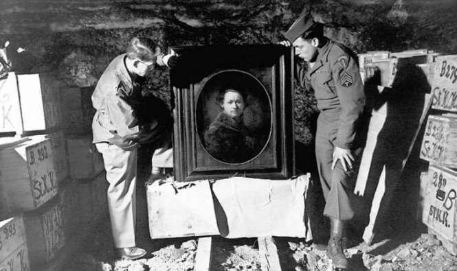 A couple of the actual Monuments Men with a stolen Rembrandt found in a German salt mine.