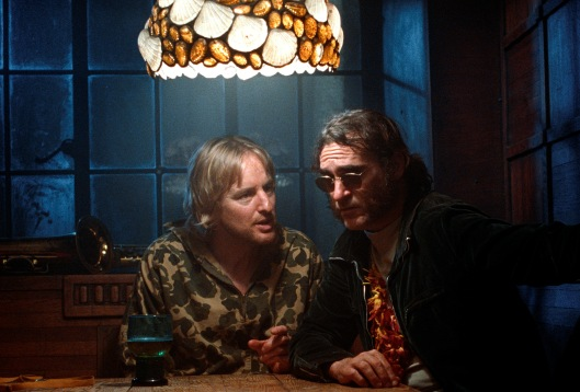 Owen Wilson and Joaquin Phoenix sleuth confusedly in 'Inherent Vice' (Warner Bros.)