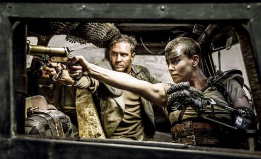 Tom Hardy and Charlize Theron fight the future (Warner Bros.)