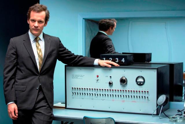 Stanley Milgram (Peter Sarsgaard) and his 'shock' machine in 'Experimenter' (Magnolia)