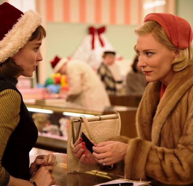 Rooney Mara and Cate Blanchett exchange Christmas cheer in 'Carol' (Weinstein)